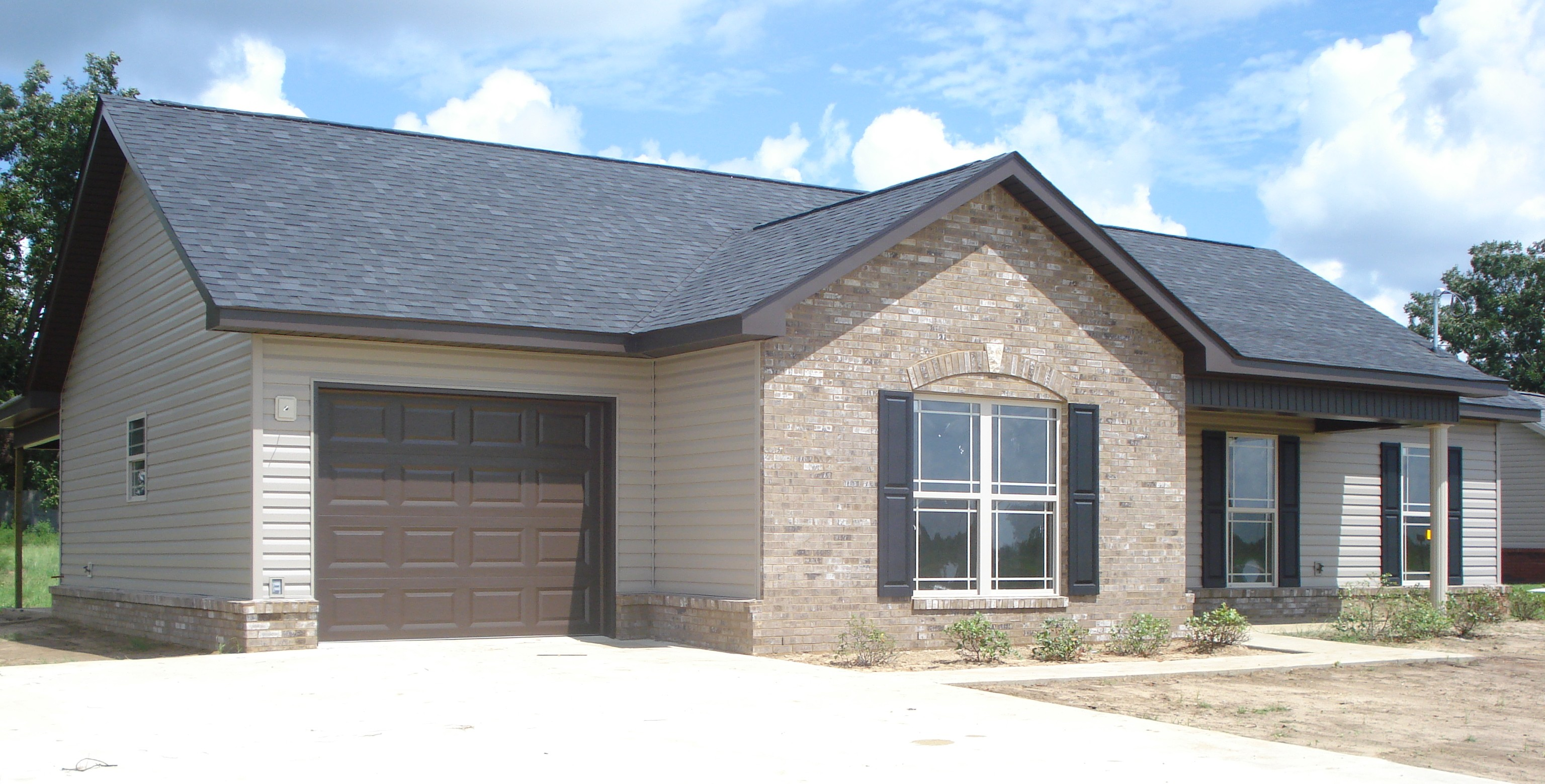 Brick Exterior: Earth Tone Exterior With Brick Accent